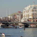 A view over the Amstel river towards the old city center, on the right hand the Amstel Hotel.